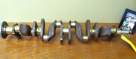 Crankshaft resting on a shelf at work. To all of you purists – fear not, it is stored standing on its end.