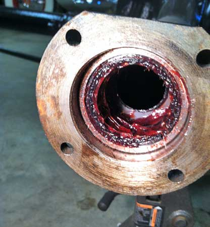 Bearing is pressed into place after grease packing.