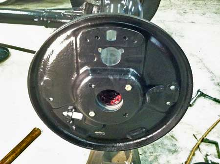 Brake backing plate is temporarily placed into position..