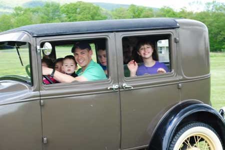 Giving several kids their first taste of antique cars in mid-May.
