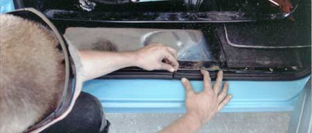 Once the correct seal was located, the weather stripping was installed. Here Ryan finishes the passenger door seal.