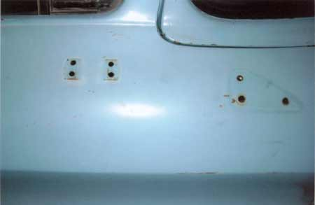 Close up detail shows location of mirror and trim pieces. Notice that the paint is best preserved where rubber gaskets covered the metal, preventing air and sunlight exposure.