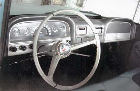 The dashboard and steering wheel shows the satin finish of interior paint. The cracked steering wheel is a common flaw and is easily repaired using epoxy filler and sanding.