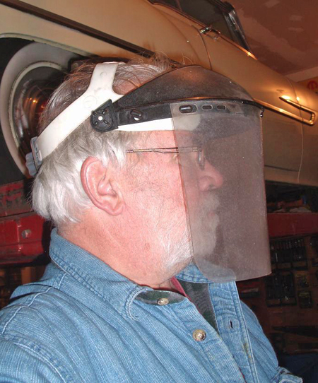 Eastwood sells this full face shield that is perfect for wire wheel work. It cost a bunch less than what a doctor will charge to extract tiny slivers of steel wire from your eyeball (after which you may still have a lot of trouble seeing).