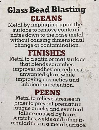 This placard lists the advantages of using a glass bead type of media. Each type of media has its own selling points and is best for certain jobs. (Photo courtesy Metal Finishing Supply Co., Brookfield, Wis.)