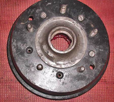 An early MG TD brake drum prior to being cabinet blasted. On a drum like this you'll want to mask off braking and bearing surfaces prior to blasting and clean afterwards. (Photo courtesy Metal Finishing Supply Co., Brookfield, Wis.)