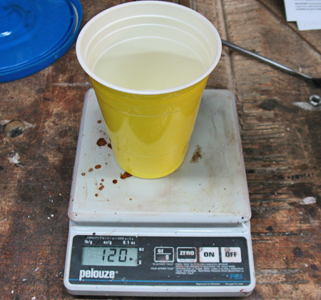 Photo 6 — A digital postal scale set to grams makes mixing the urethane rubber easy while adhering to the 1:1 mixing ratio. Don't forget to account for the weight of the cup as you measure your mixture.