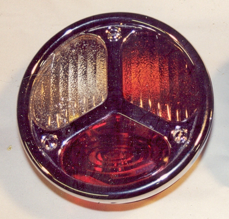 Photo 1 — TRILIN tail light assembly for the driver's (left) side is shown. Note the vertical flutes in both the clear and amber lenses. Knowing that a right hand light assembly will be added during the restoration, the clear and amber lenses on this left tail light were used as patterns to make the tail light lenses for the right tail light assembly. The tail lights will be symmetrically opposite.