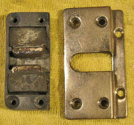 The same door bumper receiver with the decorative shroud removed to show the rubber blocks and the metal cups.