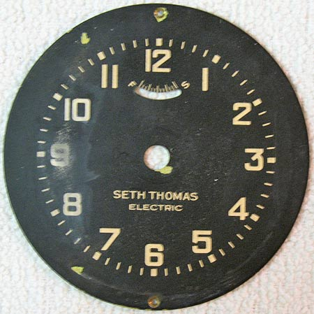 Photo 1 – The Seth Thomas clock face plate as it was received from the seller. Note the water damage to the left side around the number 9.