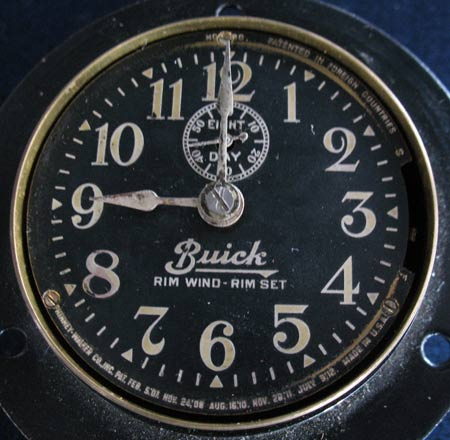 Photo 2 – Another example of a clock face plate. This Phinhey-Walker clock faceplate includes details such as the Buick logo, the words RIM WIND – RIM SET and the seconds inset dial face with the words EIGHT DAY on it. Recreating or restoring this faceplate would be virtually impossible without the aid of a good graphics program.