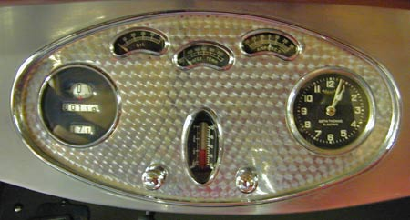 Photo 5 – The completed instrument cluster with the Seth Thomas clock installed. The clock's chrome bezel and glass hide the outer edges of the faceplate. The other gauges faceplates were in excellent condition with only the clock's faceplate requiring attention. Not restoring this faceplate would have ruined the appearance of the entire instrument cluster.