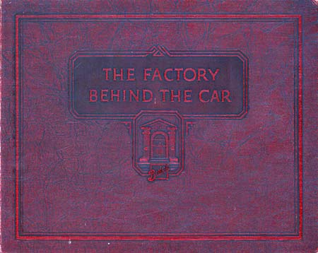 the factory behind the car