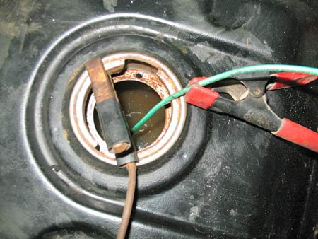 Photo 9 – A simple spring camp suspends the Anode by its green stranded wire in the tank just above the bottom to prevent shorting out. The electrical spring clip on the flange is the Cathode (negative) connection. A better connection would have been on the tanks flange away from where gas may form.