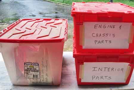 Stackable bins provide good organization for your parts into logical categories. Writing on paper or light cardboard maybe better than writing on the bin itself when planning to reuse the bin.