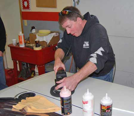 David Collard of Diamond Dave's detailing in Green Bay, Wis., demonstrates the use of a buffer and cutting compound to fix paint flaws.