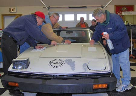 For a winter storage seminar, some talented volunteers chipped in to help Diamond Dave clean the paint with pieces of the Meguiar's clay bar.