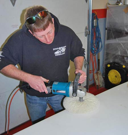 A wool pad on the Makita orbital buffer was used to do apply the Meguiar's No. 105 Cutting Compound to one section of the car after another.