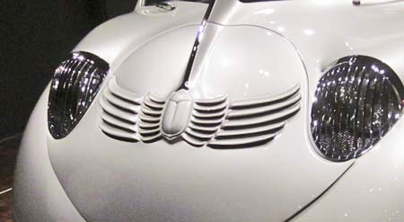 Moustache panel showing scarab beetle and ventilation intakes.