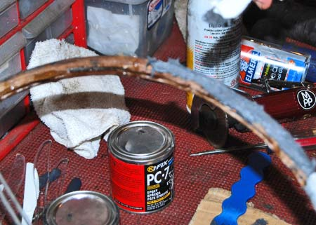 PC-7 epoxy filler from Eastwood Steering Wheel Restoration Kit was used to fill in the side gaps and the build up the sides and top of the MG rim section.