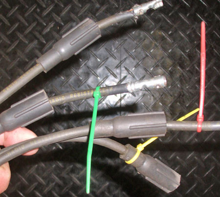 Electrical ties can also be used to color code spark plug wires from front to rear so you know which plugs to put them on. Use your own color sequence.