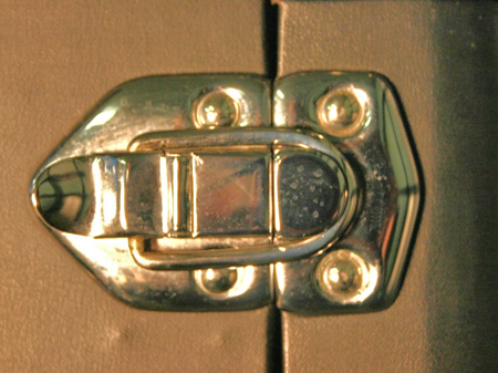 Finished view of a hasp latch after the trunk is covered. This latch was plated and used polished stainless steel truss head threaded rivets.