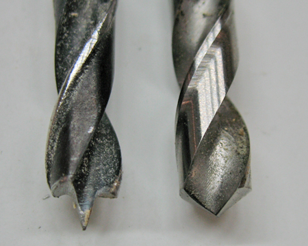Comparison of a brad point drill bit (left) and a regular metal cutting bit (right). The brad point bit ensures accurate location of the hole for the insert.