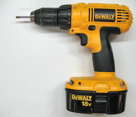 A cordless drill driver makes drilling the hole and setting the brass insert quick work when setting many inserts. Shown in the chuck is the 6-32 mandrel and an insert.