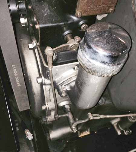 Photo 2 — View of the bell crank and control rod linkage used on the model L Lincoln advance. Make sure the bell crank is mounted correctly with the shorter arm connected to the distributor and the longer arm to the gear at the base of the steering wheel. Verify the distributor advance linkage moves freely and through its full travel.