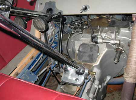 Photo 4  — Front compartment with the floor boards removed revealing the ignition timing marks on the flywheel under the clutch cover.