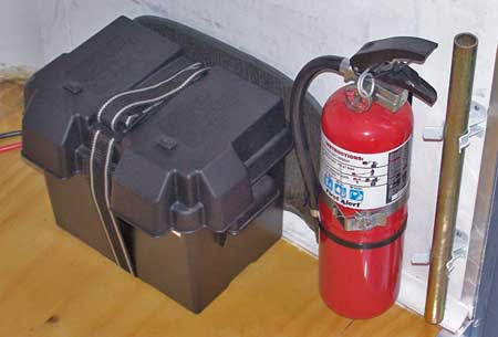 Battery dedicated to interior lighting along with a fire extinguisher in a handy location.