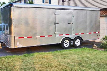 Strips of reflective tape on the side of the trailer