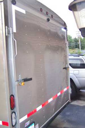 Strips of reflective tape on the back of the trailer.