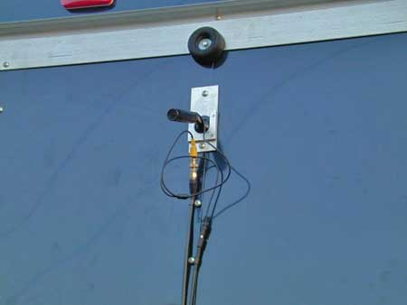 The bullet camera is mounted with as slide clip high on the trailer. Two connections are required, 12 Volt power and video signal, both satisfied using coax cable.