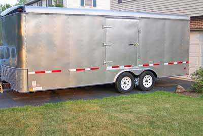 Side view of a tag along trailer showing the convenience of a side door on the left side to exit the vehicle after it's in the trailer.
