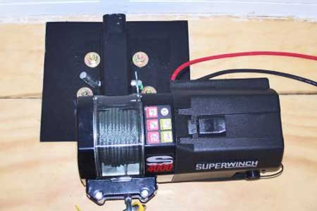 Electric winch mounted using hitch receiver.