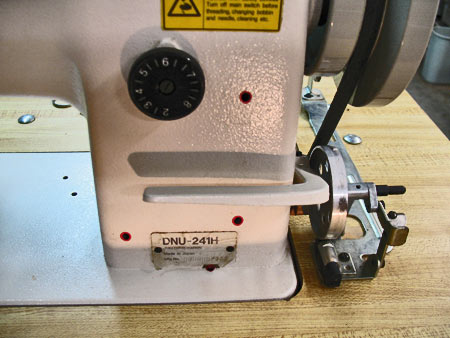 Photo 14: The horizontal lever on the right side of the machine is the reversing bar. Not all sewing machines include this feature, but is somewhat common on commercial machines such as this JUKI.