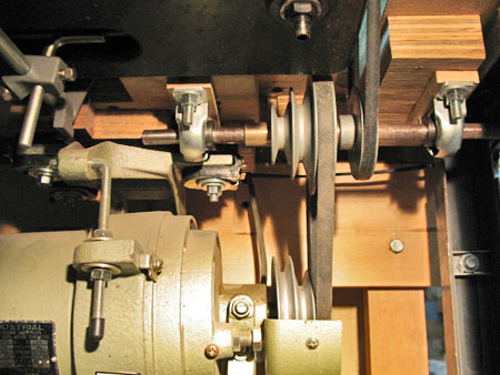 Photo: This belt and pulley arrangement was installed to intentionally slow the motor's speed to the machine. As configured, it slows the 1750 RPM motor to about 1,000 RPM and if needed the belts can be slid to different pulleys to raise the speed. The pillow blocks, shafts, belts and pulleys were purchased from McMaster Carr and Grainger.
