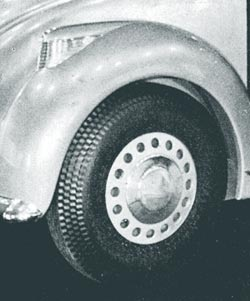 Low pressure tires and new design steel wheels are a notable 1934 trend.