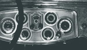 Radio is recognized by several makes, with built-in control on the dash in addition to the usual aerial equipment. Packard's neat installation is shown in the center of the instrument board.