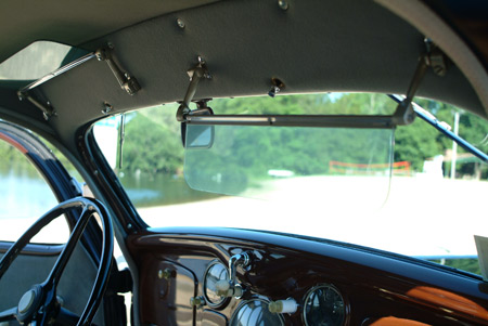 Tinted glass sun visors and a crank-open windshield were standard features of the DU series of Dodge cars.