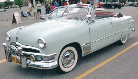 The 1950 convertible has it all including skirts, bumper guards and appletons.