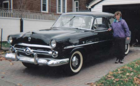 1952 Ford Customline with bumper guards.