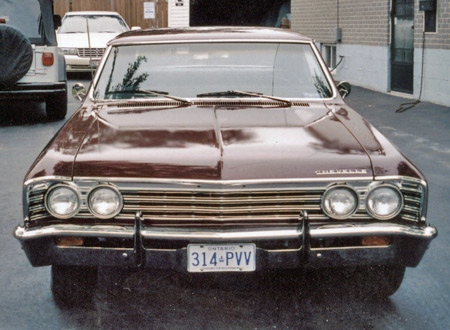 The 1967 Malibu grille is chrome while the SS feature black accents.