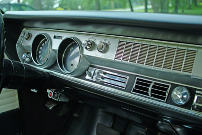 "The 1966 Oldsmobile factory brochure described this as the ""Action center for the most exciting 442 ever to put rubber to road! All instruments are recessed, glare-proof � easy to read and reach."" The padded dash and padded sun visors were standard equipment as well."