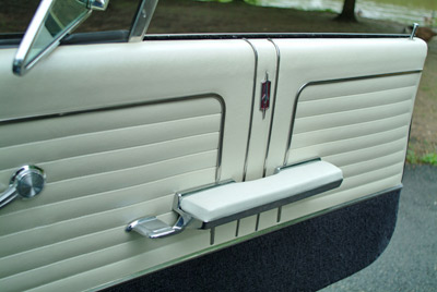 The door panels illustrate the extra bright work of the deluxe interior package that was standard equipment on the 442.