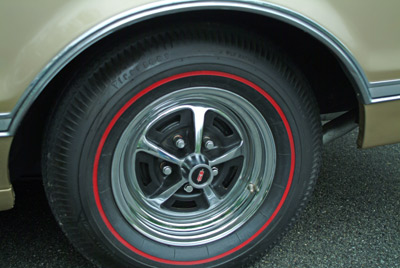 The optional chrome super stock 14� wheels with the Oldsmobile center cap give the car a distinctive look. The Red Line bias ply tires were state of the art rolling rubber in their day.