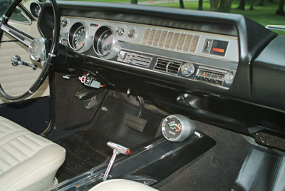 While the usual 4-speed manual trans was used in the majority of Oldsmobile 442s, this one is equipped with the 3-speed automatic Jetaway transmission. The console-mounted vacuum gauge was part of the extra-cost sports console option on the 442; based on intake manifold vacuum, it indicated either economy or performance.