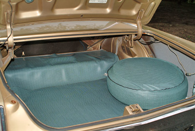 The trunk is very large and features ample stowage for luggage, golf clubs, a body or two, or what have you.