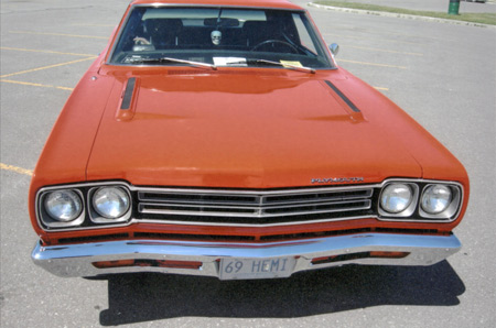 1969 Roadrunner used plastic grille divided into four rectangles and square sidemarker lenses.